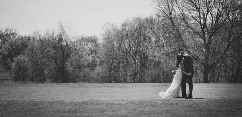 6_ bride and groom kiss